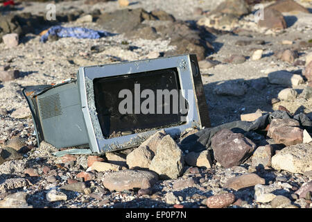 IQUIQUE, CHILE - JANUARY 23, 2015: Broken microwave oven on rocky beach on January 23, 2015 in Iquique, Chile - Stock Photo
