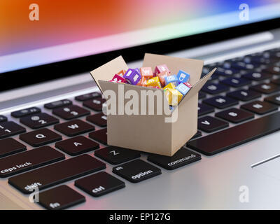 App icons and buttons for smartphone and tablet computer in cardboard box on the laptop keyboard. Mobile applications - Stock Photo