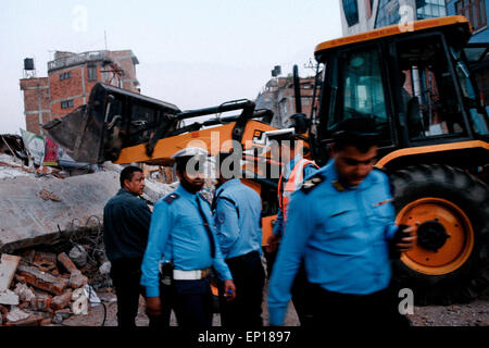 Kathmandu, Nepal. 12th May, 2015. Rescue team officials look on during their search for survivors at a collapsed - Stock Photo