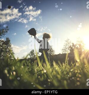Boy playing baseball - Stock Photo