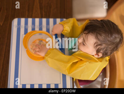 Elevated view of boy eating - Stock Photo