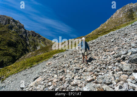 Man walking Across a Scree Slope in Arthur's Pass National Park, New Zealand - Stock Photo