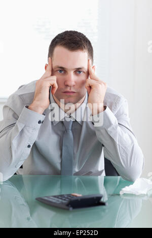 Businessman disappointed with his calculations - Stock Photo