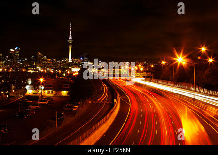 Northern Motorway and Skytower at night, Auckland, North Island, New Zealand - Stock Photo