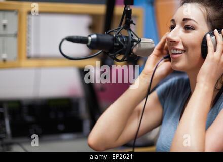 Cute radio host speaking - Stock Photo