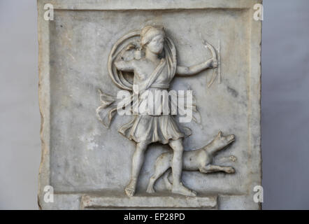 Altar dedicated to Diana victrix by Aebutia Amerina, representing Artemis as an archer running. Marble. 2nd C. AD. - Stock Photo