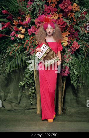 Elizabeth Jagger, daughter of Mick Jagger and Jerry Hall, wearing a hot fuchsia pink dress with an oversized orchid - Stock Photo