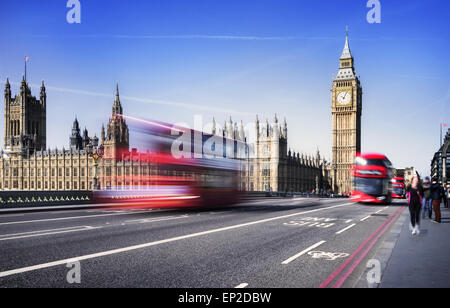 London, the UK. Red bus in motion and Big Ben, the Palace of Westminster. The icons of England in vintage, retro - Stock Photo