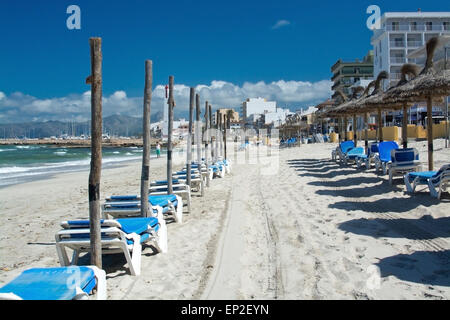 Can Picafort beach and parasol poles before season starts on a sunny spring day on April 20, 2015 in Can Picafort, - Stock Photo