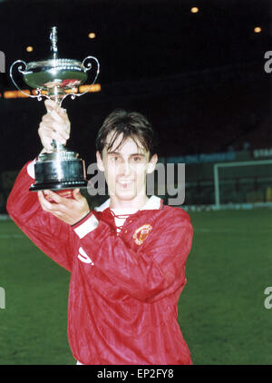 Manchester United youth team player Gary Neville holds up the FA Lancashire Youth Cup. April 1994. - Stock Photo