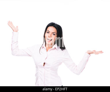 Happy businesswoman presenting something on palm over white background. Looking at camera - Stock Photo