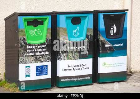 Recycling bins at Newport Sands Beach, Pembrokeshire Coast National Park, Wales in May - Stock Photo