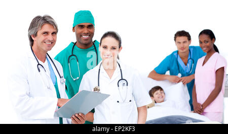Medical team in a patient's bedroom - Stock Photo