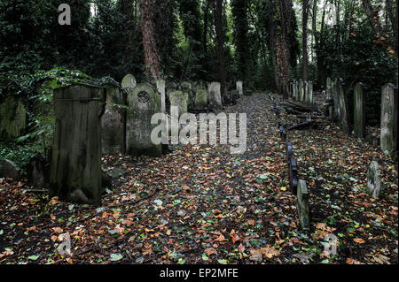 A path running through Tower Hamlets Cemetery in the East End of London. - Stock Photo