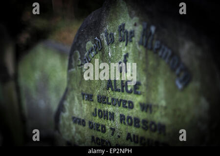 A close up view of a headstone in Tower Hamlets Cemetery in the East End of London. - Stock Photo