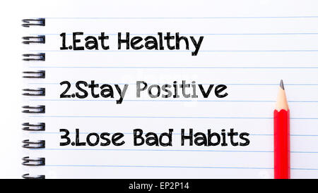 Eat Healthy, Stay Positive, Lose Bad Habits Text written on notebook page, red pencil on the right. Motivational - Stock Photo