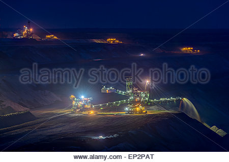Germany, Juechen, lighted spreader at brown coal mining Garzweiler by night - Stock Photo
