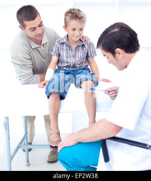 Doctor checking a patient reflexes - Stock Photo