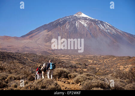 Spain, Canary Islands, Tenerife, hiking group in front of Teide Volcano - Stock Photo