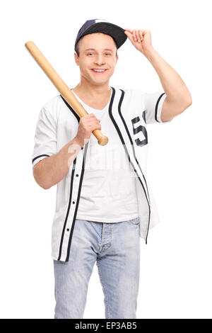 Vertical shot of a young baseball player in a white jersey, holding a bat isolated on white background - Stock Photo