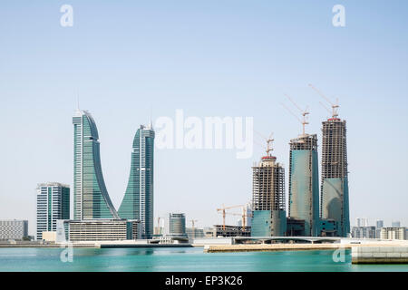 View of new office towers under construction at Bahrain Financial Harbour district in Manama Bahrain - Stock Photo