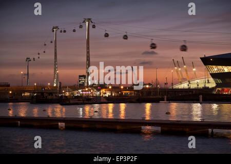 London's cable car over the Thames at sunset - Stock Photo