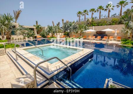 Swimming pool at new luxury  Four Seasons Hotel Bahrain Bay in Manama Kingdom of Bahrain - Stock Photo