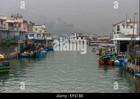 View of the stilt houses on the waterway of Tai O fishing Village located on Lantau Island, Hong Kong, china - Stock Photo