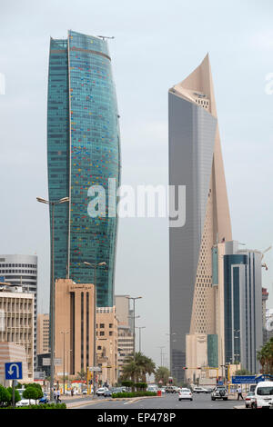 Modern skyscrapers (Kipco Tower on left and Al Hamra Tower) in Central Business District CBD of Kuwait City , Kuwait. - Stock Photo