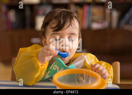 Baby boy eating - Stock Photo