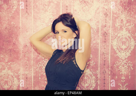 Woman with her hands behind her head - Stock Photo