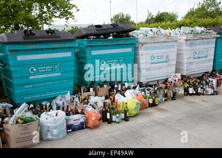 Glass recycling bins which are overfull await collection in the Winnall area of Winchester Hampshire UK - Stock Photo