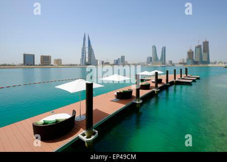 View of Bahrain skyline and Bahrain Bay from new Four Seasons Bahrain Bay luxury Hotel in Bahrain - Stock Photo