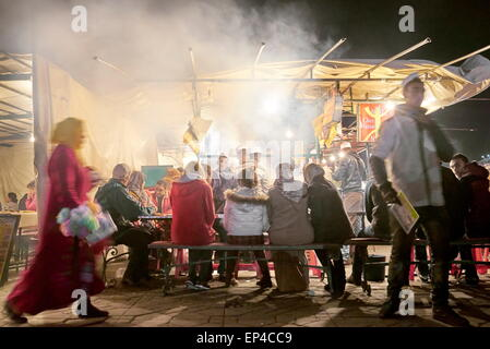 Street restaurant at Djemaa el Fna Square at night, Marrakech Medina, Morocco, Africa - Stock Photo