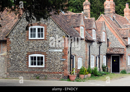 A row of flint cottages in Hambleden, Buckingshamshire. Hambleden is a picturesque village in the Chiltern Hills - Stock Photo