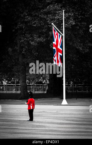 Queen's royal guard and Union Jack at the Queen's birthday parade rehearsal, London, England - Stock Photo