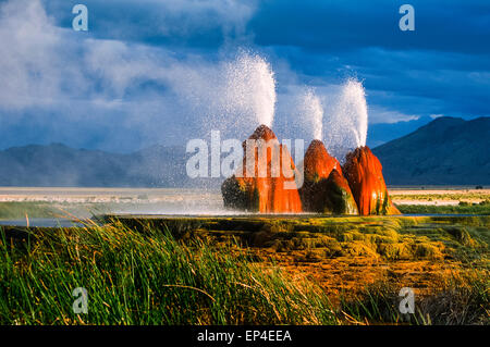 The unique Fly Geyser formation in the Black Rock desert of Nevada is the result of geothermal exploration. - Stock Photo