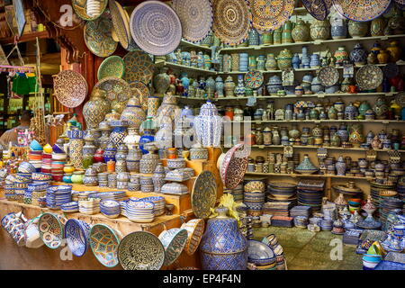 Fez, Souk in Medina, Hand painting ceramic products. Morocco - Stock Photo