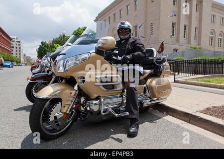 African American man sitting on Honda Goldwing (GL1800) motorcycle - USA - Stock Photo