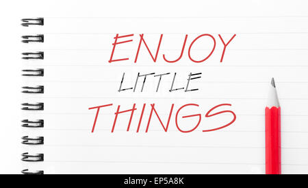 Enjoy Little Things Text written on notebook page, red pencil on the right. Motivational Concept image - Stock Photo
