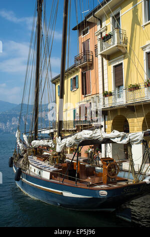 Boats and hotels in the beautiful harbour area of Malcesine on Lake Garda, Italy - Stock Photo