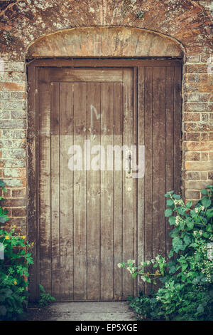 Front Door And Porch Of A Rustic English Country Cottage In The Stock Photo