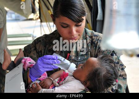 Kathmandu, Nepal. 13th May, 2015. U.S. Navy Petty Officer 2nd Class Jessica Gomez-Hickman, Marine Light Attack Helicopter - Stock Photo