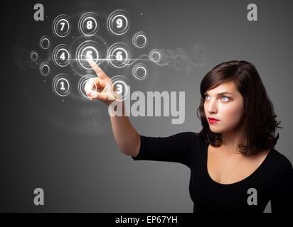 Businesswoman pressing high tech type of modern buttons - Stock Photo
