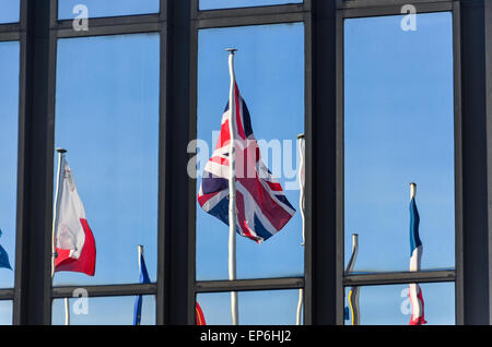 Union Jack and flags of the European Union countries reflecting on the glass windows of the European Commission, - Stock Photo