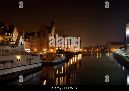 Autumn evening in Gdansk along the Motlawa River. In full view of the Zuraw and various docked boats. - Stock Photo