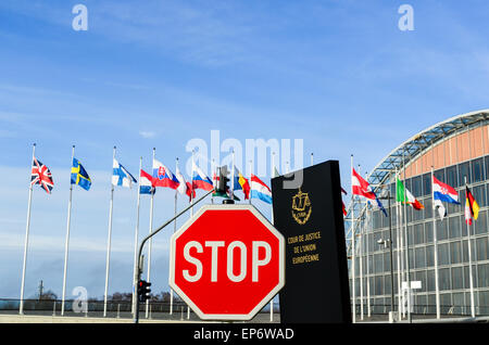 STOP sign in front of the entrance of the Court of Justice of the European Union, in European Quarter, Kirchberg, - Stock Photo