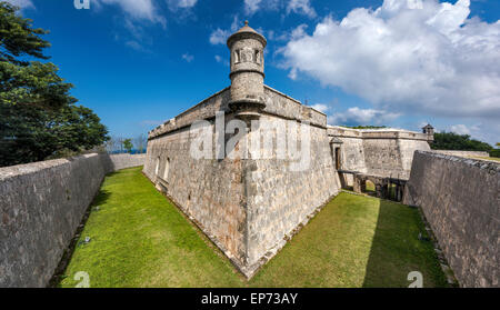 Turret at defensive wall over dry moat at Fuerte de San Miguel in Campeche, Yucatan Peninsula, Mexico - Stock Photo