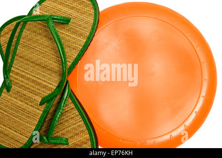 Summer Sandals With Frisbee Disc and Copy Space Isolated on white. - Stock Photo