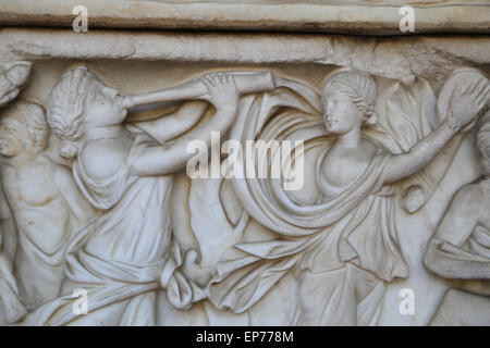 Sarcophagus with Dionysiac ceremonial procession. Maenads dancing. 2nd C. Roman style. Relief. - Stock Photo